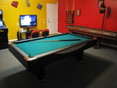 games room with billiards pool table tv arcade and movie memorabilia on walls